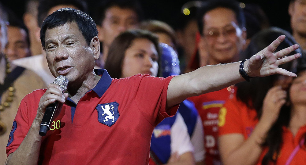 Philippine presidential race front-runner Davao city mayor Rodrigo Duterte gestures during his final campaign rally in Manila, Philippines on Saturday, May 7, 2016.