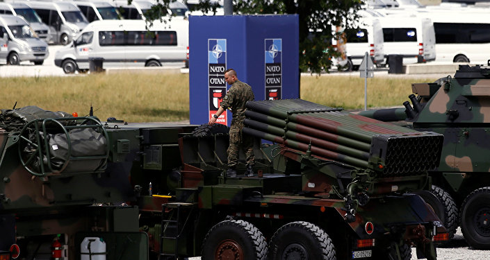 Polish soldier prepares a military exhibition in front of the venue of the NATO Summit, which will start in two days, in Warsaw, Poland, July 6, 2016.