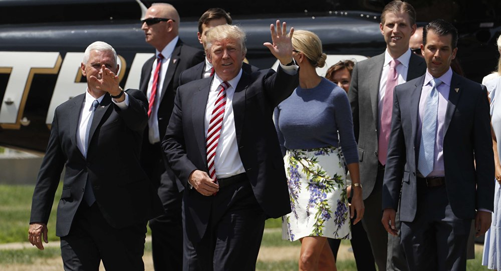 Republican U.S. presidential nominee Donald Trump (C) walks with vice presidential candidate Mike Pence (L) and family members after arriving for an event on the sidelines of the Republican National Convention in Cleveland, Ohio, U.S., July 20, 2016
