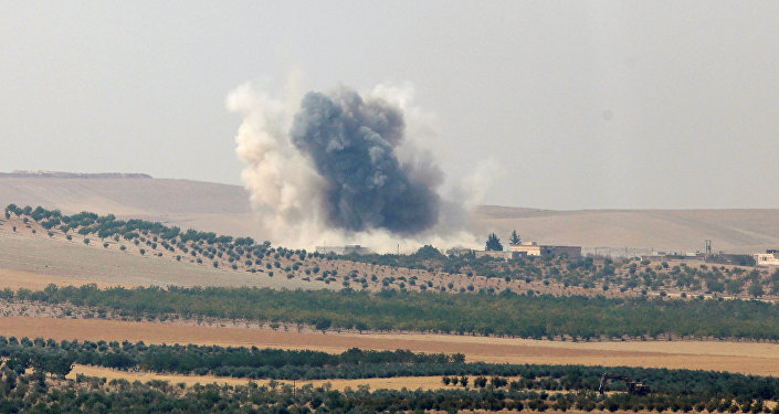 Smoke rises from the Syrian border town of Jarablus as it is pictured from the Turkish town of Karkamis, in the southeastern Gaziantep province, Turkey, August 24, 2016