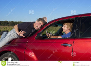 senior-woman-texting-driving-car-accident-15818520