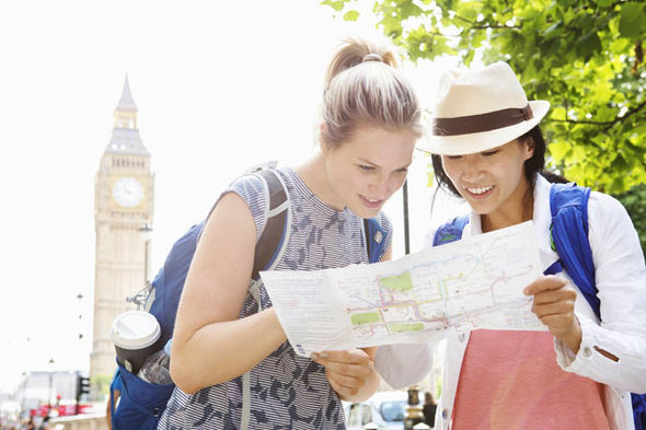 tourists looking at map in London