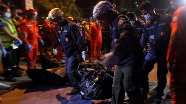 Rescuers carry a body bag after an explosion at a market in Davao City on Friday night.