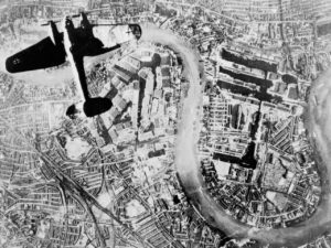 A Heinkel He 111 bomber flying over London, 1940. Since the First World War the government had feared that London would be the target of aerial bombardment. In 1938 the basement of a Whitehall building was chosen as the site for the Cabinet War Rooms