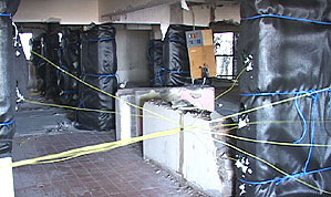 A building being prepped for a controlled demolition.