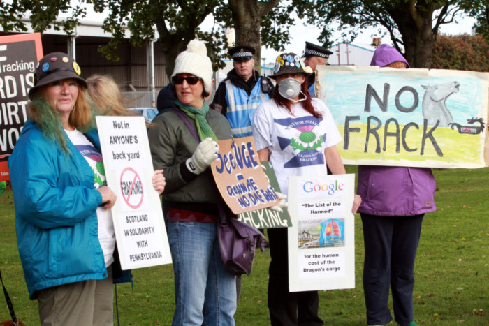 Protesters outside Grangemouth oil refinary on the day when the Ineos Insight gas carrier arrives at Grangemouth