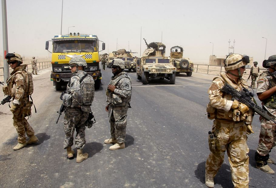 UK, US, and Iraqi soldiers at a checkpoint in Basra, Iraq in 2008. U.S. Army / Flickr