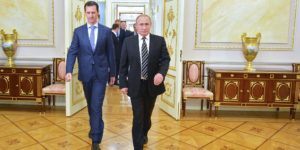 """Russian President Vladimir Putin (R) greets his Syrian counterpart Bashar al-Assad upon his arrival for a meeting at the Kremlin in Moscow on October 21, 2015. Assad, on his first foreign visit since Syria's war broke out, told his main backer and counterpart Putin in Moscow that Russia's campaign in Syria has helped contain """"terrorism"""". AFP PHOTO / RIA NOVOSTI / KREMLIN POOL / ALEXEY DRUZHININ (Photo credit should read ALEXEY DRUZHININ/AFP/Getty Images)"""