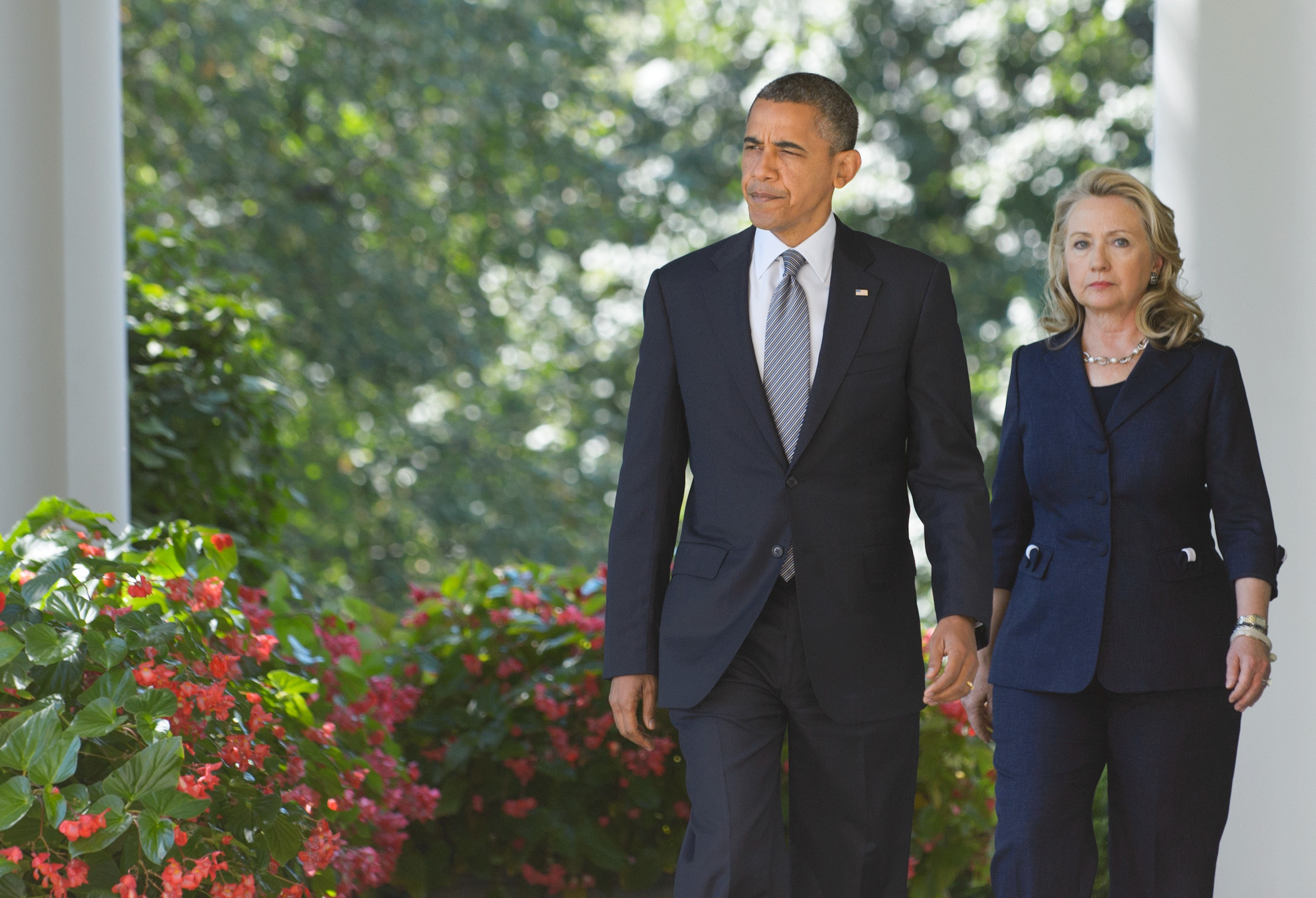 Image result for Secretary of State Hillary Clinton walks with President Barack Obama on Sept. 12, 2012