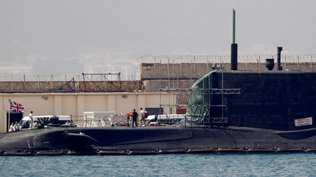 A man leaves the British nuclear Astute-class submarine HMS Ambush © Jon Nazca