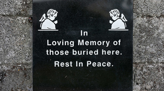 Chilling words of the plaque errected outside the burial ground at Tuam.