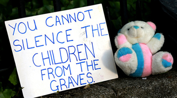 Sign held by protesters of the alck of investigation into the burial at Tuam.