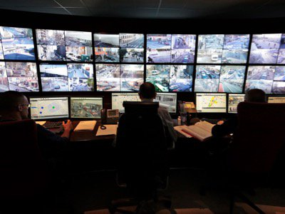 Municipal police officers watch screens in the video surveillance control room of the municipal police supervision centre in Nice