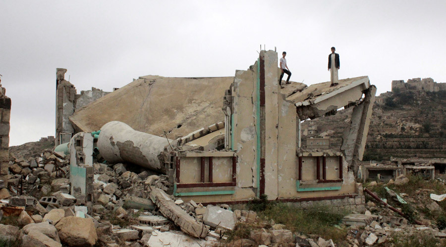 Boys stand on the collapsed roof of a mosque, which has been recently hit by a Saudi-led air strike, in the northwestern province of Saada, Yemen © Naif Rahma