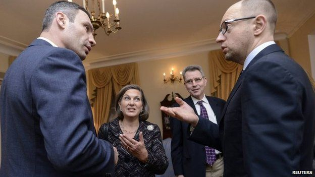 Ukrainian opposition leaders Vitaly Klitschko (L) and Arseny Yatsenyuk (R) meet with U.S. Assistant Secretary of State for European and Eurasian Affairs Victoria Nuland (2nd L) in Kiev February 6, 2014.