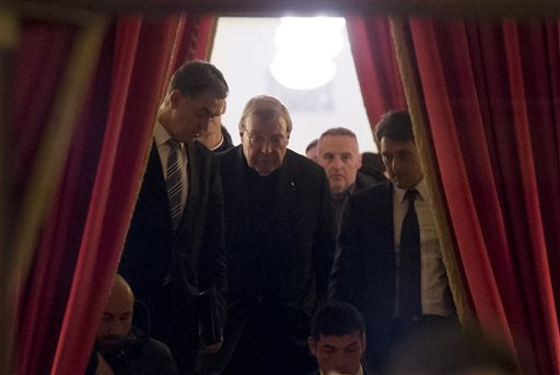Cardinal George Pell, second from left, walks in the hall of the Quirinale hotel in Rome early Monday, Feb. 29, 2016 after he testified via videolink for four hours from the Rome hotel to the Royal Commission sitting in Sydney. One of Pope Francis' top advisers acknowledged Sunday that the Catholic Church
