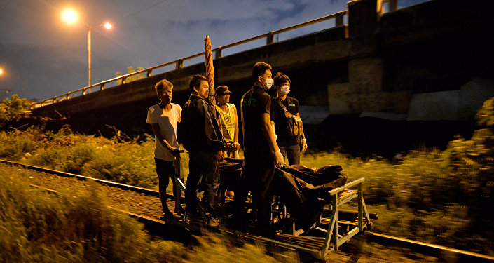 Residents transport on a trolley two bodies of men, after police said they were killed by policemen after they fought back during an illegal drugs Shabu (Meth) operation in Manila, Philippines August 18, 2016