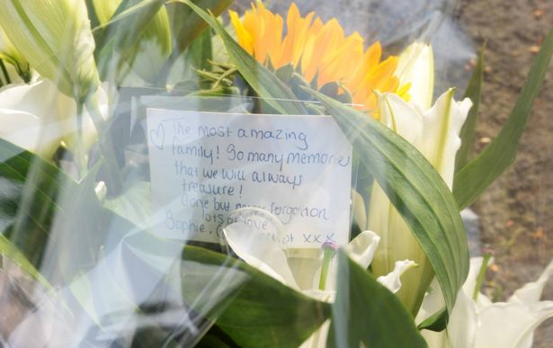 Flowers left in tribute to an 'amazing family'.