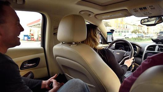 A Lyft driver and passengers
