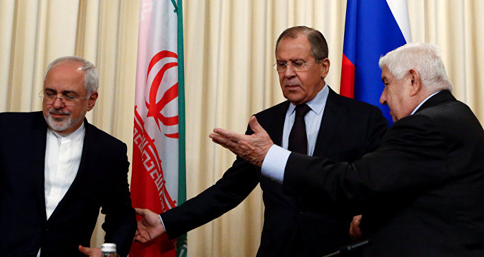 Russian Foreign Minister Sergei Lavrov (C) and his counterparts Walid al-Muallem (R) from Syria and Mohammad Javad Zarif from Iran attend a news conference in Moscow, Russia, October 28, 2016.