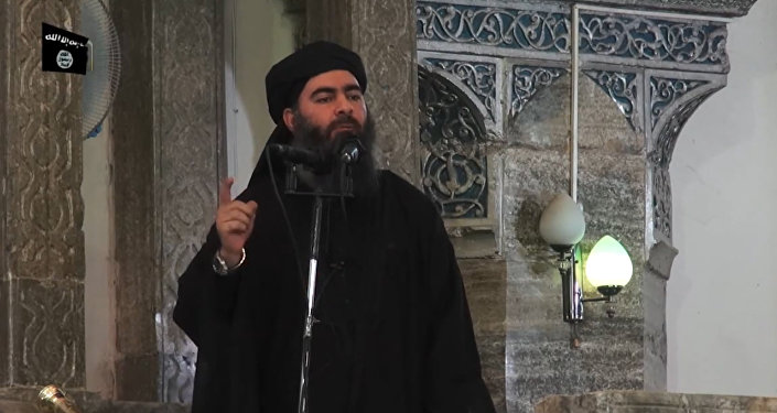 This July 5, 2014 photo shows an image grab taken from a propaganda video released by al-Furqan Media allegedly showing the leader of the Islamic State (IS) jihadist group, Abu Bakr al-Baghdadi, aka Caliph Ibrahim, adressing Muslim worshippers at a mosque in the militant-held northern Iraqi city of Mosul