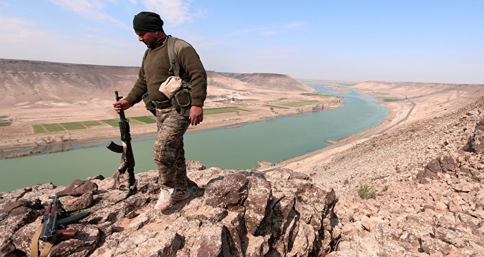 A Syrian Democratic Forces(SDF) fighter poses for a picture near Euphrates River, north of Raqqa city, Syria March 8, 2017