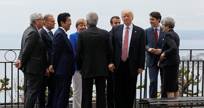 U.S. President Donald Trump gathers with (L-R) European Commission President Jean-Claude Juncker, European Council President Donald Tusk, Japanese Prime Minister Shinzo Abe, German Chancellor Angela Merkel, Italian Prime Minister Paolo Gentiloni, French President Emmanuel Macron, Canadian Prime Minister Justin Trudeau and Britain's Prime Minister Theresa May as they attend the G7 Summit in Taormina, Sicily, Italy, May 26, 2017.