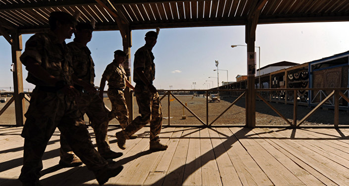 UK soldiers walk at a base in Kandahar on May 6, 2010.