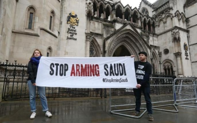 campaigners holding a banner outside the High Court in London