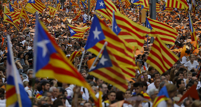 People wave pro-independence Catalan flags, known as the Estelada flag, during a rally calling for the independence of Catalonia, in Barcelona, Spain.