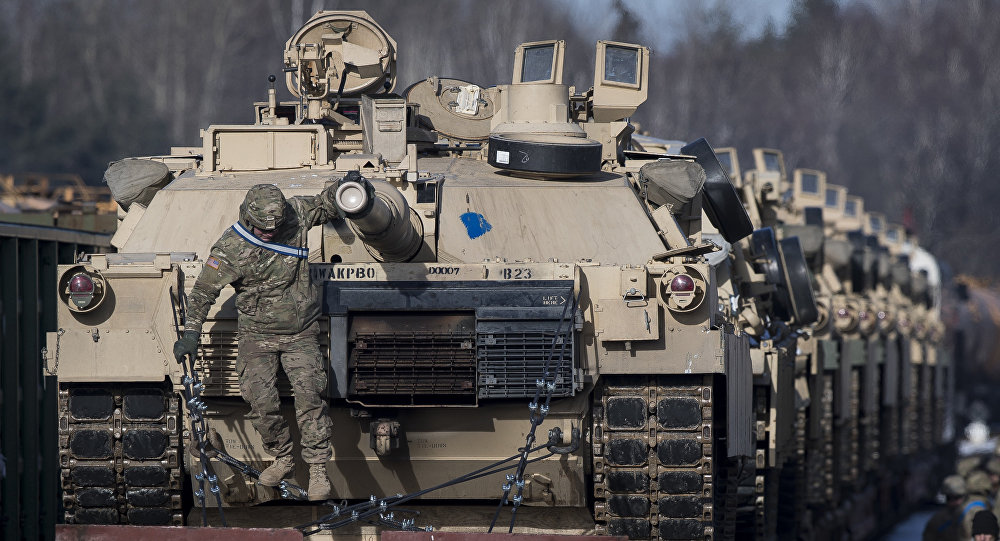 Abrams battle tanks from the US Army's 4th Infantry Division 3rd Brigade Combat Team 68th Armor Regiment 1st Battalion on rail cars as they arrive at the Gaiziunai railway station some 110 kms (69 miles) west of the capital Vilnius, Lithuania, Friday, Feb. 10, 2017.