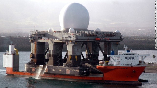 060109-N-3019M-012 Pearl Harbor, Hawaii (Jan. 9, 2006) - The heavy lift vessel MV Blue Marlin enters Pearl Harbor, Hawaii with the Sea Based X-Band Radar (SBX) aboard after completing a 15,000-mile journey from Corpus Christi, Texas. SBX is a combination of the world???s largest phased array X-band radar carried aboard a mobile, ocean-going semi-submersible oil platform. It will provide the nation with highly advanced ballistic missile detection and will be able to discriminate a hostile warhead from decoys and countermeasures. SBX will undergo minor modifications, post-transit maintenance and routine inspections in Pearl Harbor before completing its voyage to its homeport of Adak, Alaska in the Aleutian Islands. U.S. Navy photo by Journalist 2nd Class Ryan C. McGinley (RELEASED)