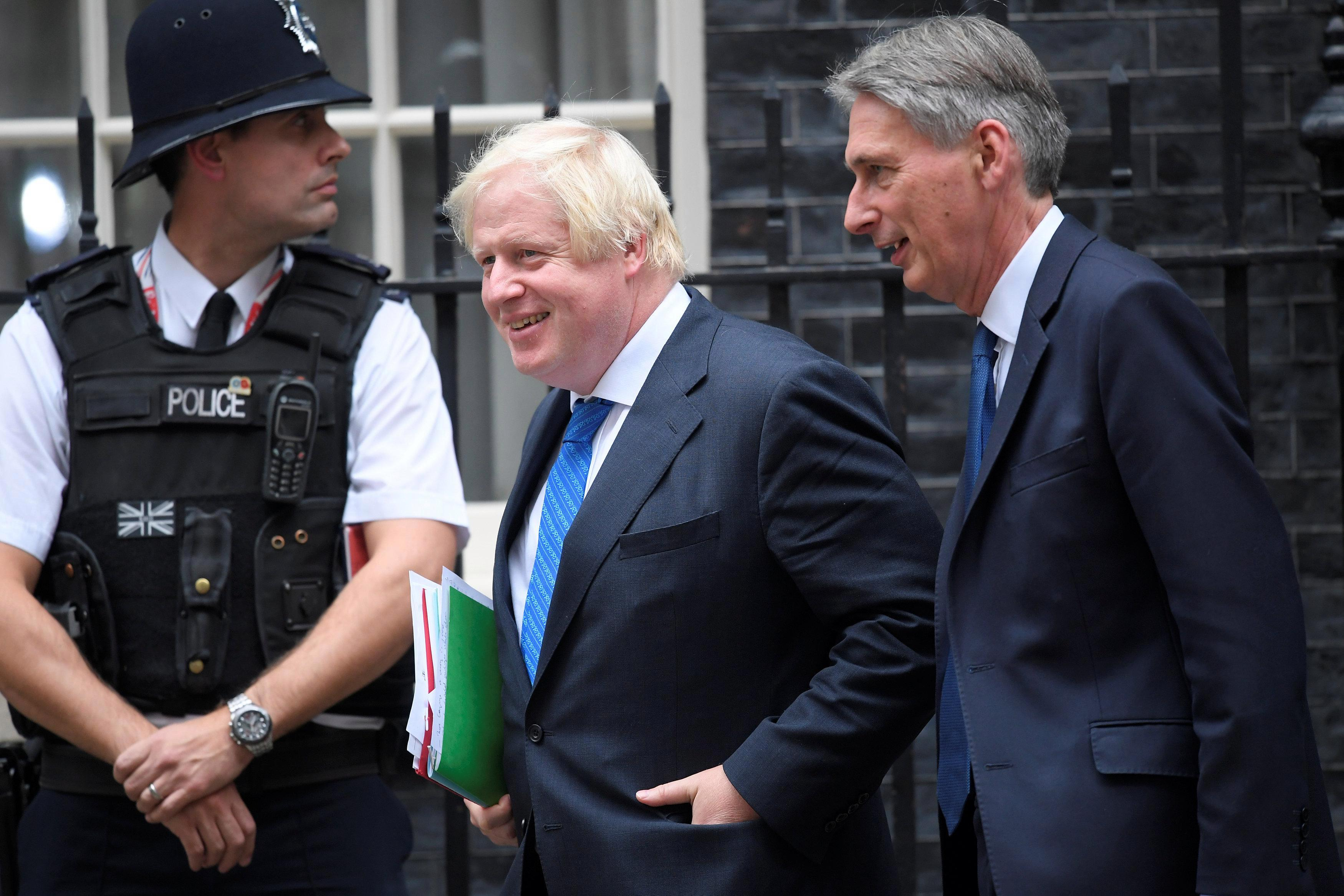 Don't be fooled by the smiles as Boris Johnson and arch-enemy Philip Hammond put on a show of 'false unity'
