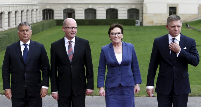 Prime Ministers of the Visegrad Group (V4), Hungary's Prime Minister Viktor Orban (L-R), Czech Republic's Prime Minister Bohuslav Sobotka, Poland's Prime Minister Ewa Kopacz and Slovakia's Prime Minister Robert Fico pose for a group photo during an extraordinary Visegrad Group summit aimed at resolving the migration crisis in Prague, Czech Republic, September 4, 2015.