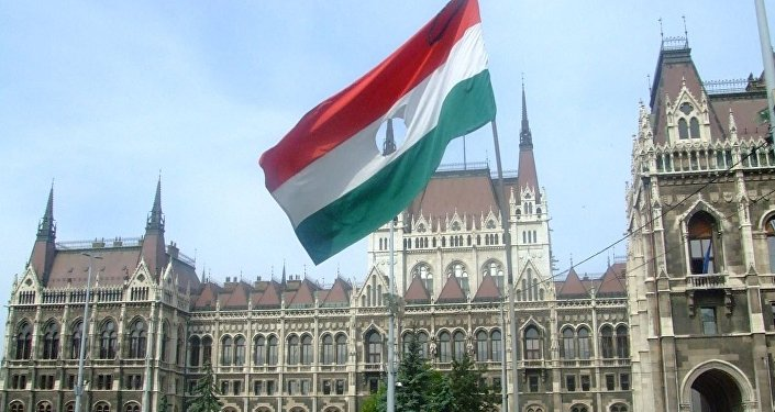 A flag from the 1956 Hungarian Revolution on the memorial to the victims located outside the Hungarian Parliament Building