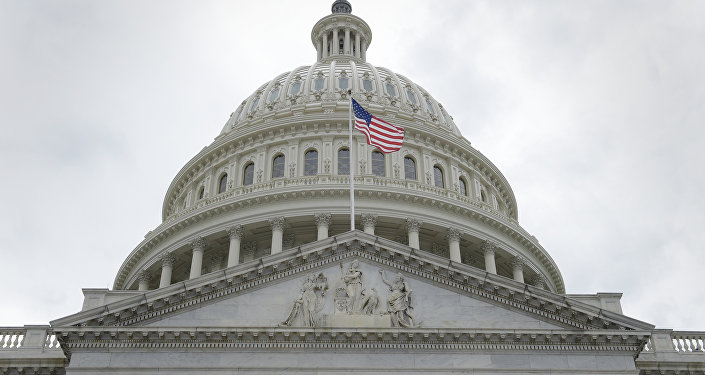 In this May 4, 2017, file photo, the U.S. flag flies in front of the Capitol dome on Capitol Hill in Washington