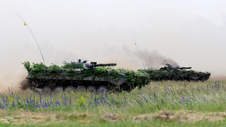 FILE PHOTO Poland's army tanks attend the final day of NATO Saber Strike exercises in Orzysz, Poland © Ints Kalnins