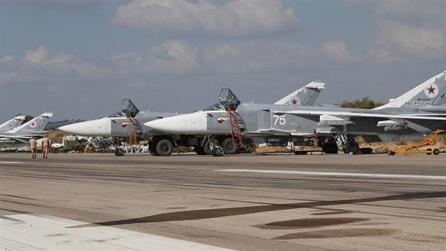 A general view shows Russian fighter jets on the tarmac at the Hmeimim military base in Latakia province, in the northwest of Syria, on February 16, 2016. (Photo by AFP)