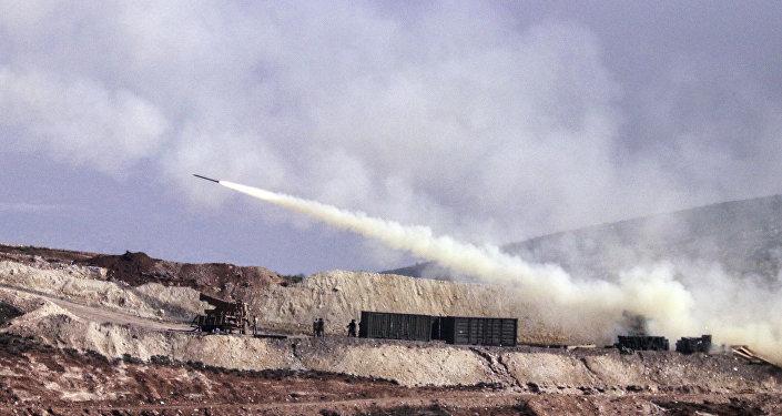 Turkish artillery fires toward Syrian Kurdish positions in Afrin area, Syria, from Turkish side of the border in Hatay, Turkey, Friday, Feb. 9, 2018