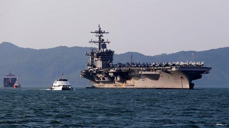 U.S. Navy aircraft carrier, USS Carl Vinson, docks at a port in Danang, Vietnam March 5, 2018. © Nguyen Huy Kham
