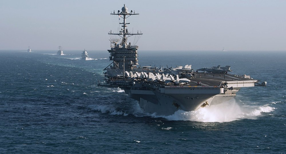 The aircraft carrier group of the United States Navy led by USS Harry S. Truman, front, and a ship escort are seen leaving the port of Norfolk heading for the Middle East. File photo