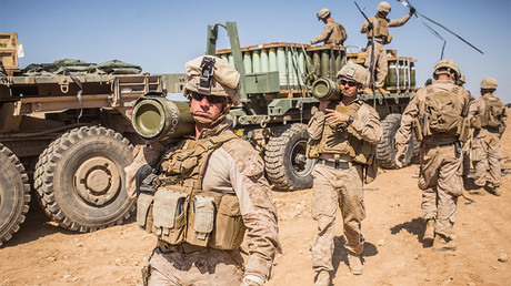 FILE PHOTO: U.S. Marines carry 155mm rounds to an M777 Howitzer gun line in preparation for fire missions in northern Syria as part of Combined Joint Task Force - Operation Inherent Resolve © U.S. Army