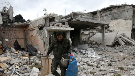 FILE PHOTO: A man walks on rubble of damaged buildings in the town of Douma, Eastern Ghouta © Bassam Khabieh