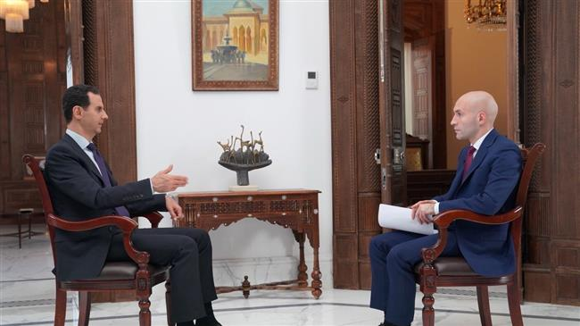 The photo shows Syria's President Bashar al-Assad speaking during an interview with Russia's RT on May 31, 2018.