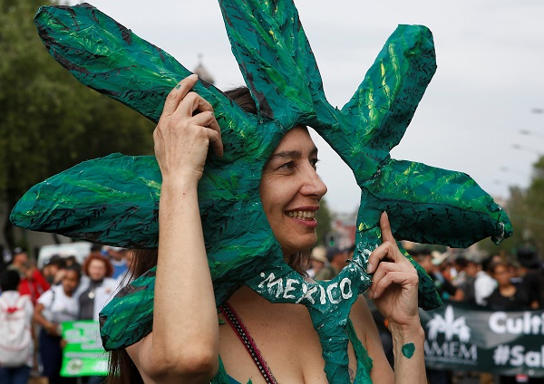 The first Saturday of May has been reserved by cannabis users around the world since 1999 for the Global Marijuana March. Here, a woman takes part in a march through the streets of Mexico City in support of the legalization of marijuana.