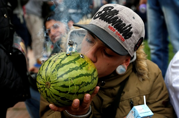 A man smoking cannabis through a watermelon during the Global March for Marijuana in Bogota, Colombia. Marches were held in cities around the world, including Mexico, Bogota and Rio de Janeiro in Latin America.
