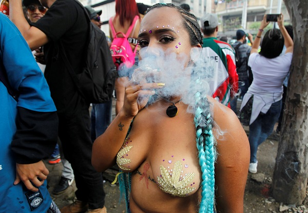 A woman joins the Global March for Marijuana in Medellin, Colombia.