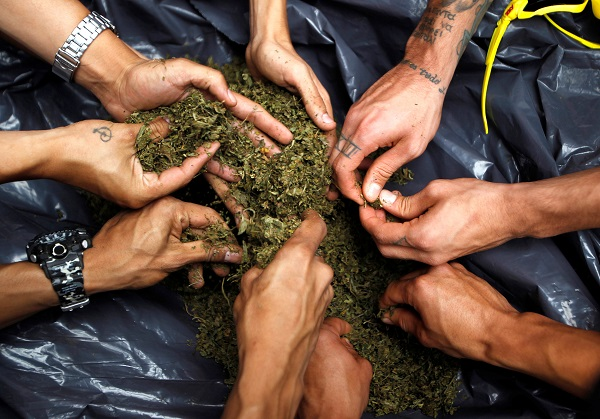 Men prepare a joint during during the Global March for Marijuana in Medellin, Colombia. Since 1999, hundreds of thousands of people have participated in over 829 different cities in 72 countries.