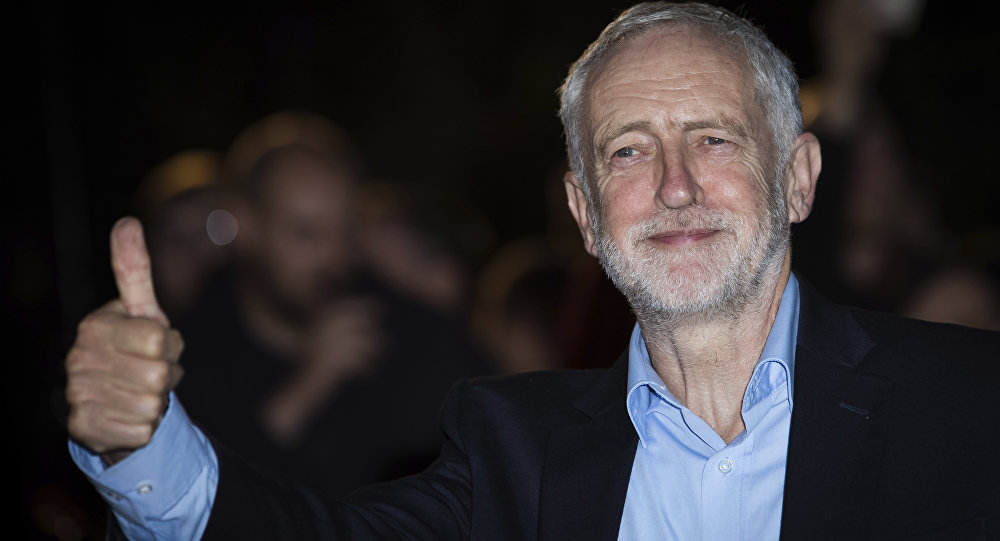 Jeremy Corbyn poses for photographers upon arrival at the GQ's Men of The Year awards, in London, Tuesday, Sept. 5, 2017.