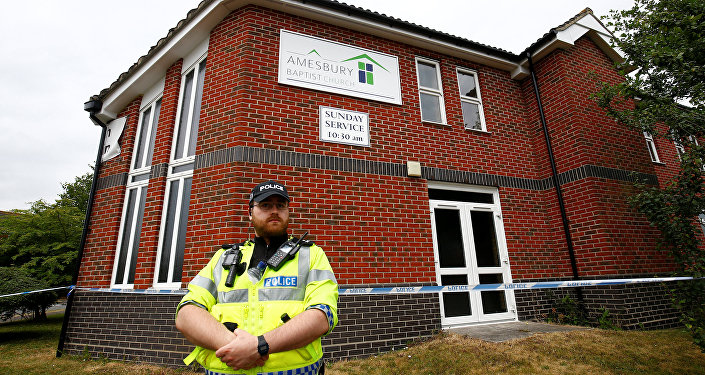A police officer stands in front of Amesbury Baptist Church, which has been cordoned off after two people were hospitalised and police declared a 'major incident', in Amesbury, Wiltshire, Britain, July 4, 2018
